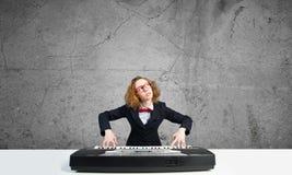 Mad woman play piano Royalty Free Stock Photo