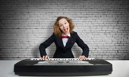 Mad woman play piano Royalty Free Stock Photos