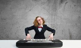 Mad woman play piano Stock Photo