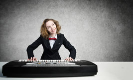 Mad woman play piano Stock Photography