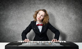 Mad woman play piano Stock Images