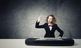 Mad woman play piano Royalty Free Stock Photography