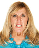Mad Woman Scowling. Single mad scowling blond female over white Stock Photo