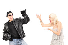 Mad Woman Yelling At Her Biker Boyfriend Royalty Free Stock Photo