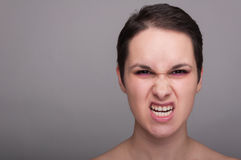 Mad young female acting rude Royalty Free Stock Image