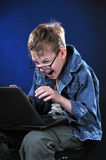 Mad Young Gamer. The boy of ten years acts part mad gamer Stock Image