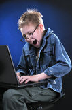 Mad Young Hacker. The boy of ten years acts part mad hacker Stock Image