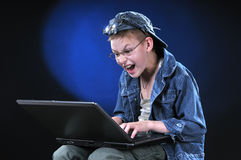 Mad Young Hacker. The boy of ten years acts part mad hacker Stock Images