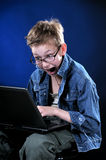 Mad Young Hacker. The boy of ten years acts part mad hacker Royalty Free Stock Photography