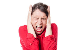 Mad young woman screaming, covering her ears to refuse to listen Royalty Free Stock Photo