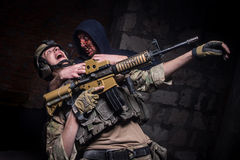 Mad zombie attacked soldier with gun Royalty Free Stock Images