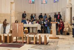 An international group of believers makes a group prayer service in Memorial Church of Moses on Mount Nebo near the city of Madaba. Madaba, Jordan, December 05 royalty free stock photos