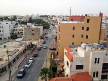 Madaba From a Lookout. Madaba, Jordan - May 27, 2015: In the heart of the city the natives are going on with their daily lives royalty free stock images