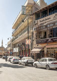 Madaba street. With shops and cars on a sunny day. It is an editorial image vertically Royalty Free Stock Images