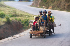 Madagascar cart. Some local kids coming downhill on a selfmade cart near Ambositra, Madagascar on September 5, 2013 Stock Images