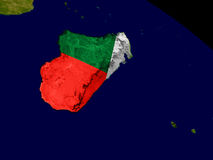 Madagascar with flag on Earth Stock Images