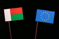 Madagascar flag with European Union EU flag isolated on black. Background Royalty Free Stock Images