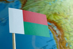 Madagascar flag with a globe map as a background Royalty Free Stock Images