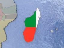 Madagascar with flag on globe Royalty Free Stock Photo