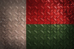 Madagascar flag,metal texture on background Royalty Free Stock Images