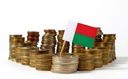 Madagascar flag with stack of money coins Stock Photos