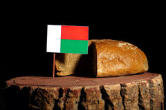Madagascar flag on a stump with bread. Isolated Royalty Free Stock Photography