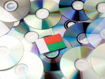 Madagascar flag on top of CD and DVD pile isolated on white. Madagascar flag on top of CD and DVD pile isolated Stock Image