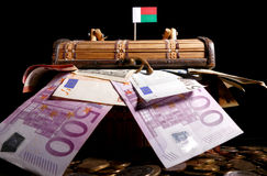 Madagascar flag on top of crate. Full of money Royalty Free Stock Images
