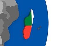 Madagascar on globe with flag Royalty Free Stock Photos