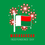 Madagascar. Independence day. Independence day of Madagascar. Greeting card. Flag and fireworks on a green background. Vector illustration Stock Images