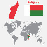 Madagascar map on a world map with flag and map pointer. Vector illustration Royalty Free Stock Images
