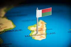 Madagascar marked with a flag on the map.  royalty free stock photo