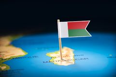 Madagascar marked with a flag on the map.  stock photography