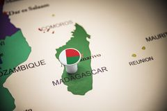 Madagascar marked with a flag on the map.  royalty free stock photography