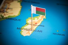 Madagascar marked with a flag on the map.  royalty free stock photos