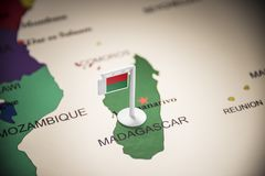 Madagascar marked with a flag on the map.  royalty free stock images