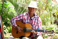 Madagascar musician plays music on a sunny day Royalty Free Stock Photos