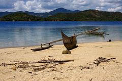 Madagascar nosy be boat palm  rock stone branch  lagoon and coa Royalty Free Stock Photos