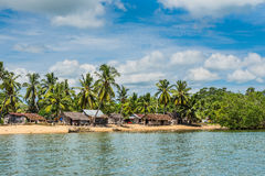 Madagascar Nosy Be island village and fisherman pirogues canoes Royalty Free Stock Image