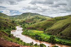 Madagascar. Red water of the river of Tsiribihina with mountains on the background, Madagascar Stock Image