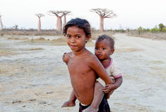Madagascar-shy and poor african girl with infant Royalty Free Stock Photo