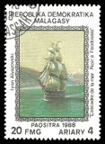 The Squadron of the Sea Black Feodossia by Ivan Aivazovski. Madagascar - stamp 1988: Color edition on Art, shows Painting The Squadron of the Sea Black Feodossia Royalty Free Stock Images