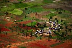 Madagascar. Traditional Malagasy village among red soils. Madagascar Stock Photos