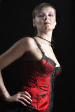 Madam in red corset Royalty Free Stock Photo