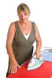 Madame aînée Ironing Photos libres de droits