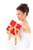 Madame avec le présent sur Noël Photographie stock