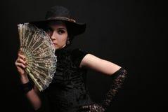 Madame avec un ventilateur Photographie stock