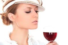 Madame avec une glace de vin Image libre de droits