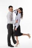 Madame d'affaires flirtant avec le commis Image stock