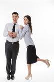 Madame d'affaires flirtant avec le commis Photographie stock libre de droits